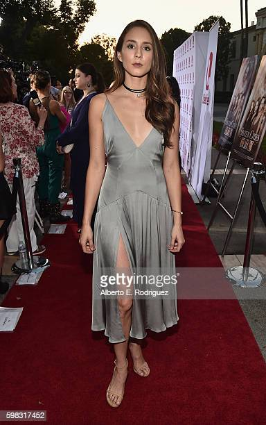 "Actress Troian Bellisario attends the premiere of Lifetime's ""Sister Cities"" at Paramount Theatre on August 31, 2016 in Hollywood, California."