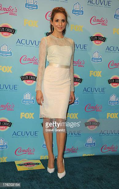 Actress Troian Bellisario poses in the press room at the 2013 Teen Choice Awards at Gibson Amphitheatre on August 11 2013 in Universal City California
