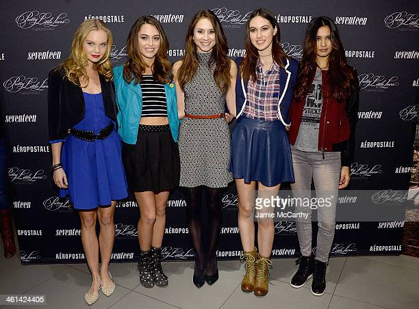 Actress Troian Bellisario with models wearing Pretty Little Liars Fashion Collection by Aeropostale pose during the Pretty Little Liars fashion...