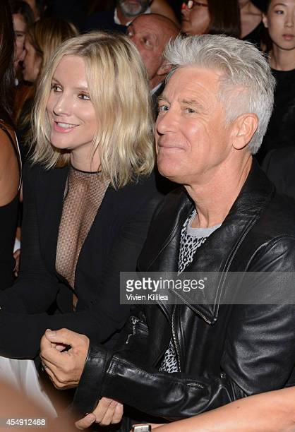 Actress Trudie Styler and musician Adam Clayton attend the Edun fashion show during MercedesBenz Fashion Week Spring 2015 at Skylight Modern on...