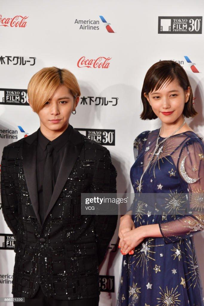 Actress Tsubasa Honda and actor Ryosuke Yamada arrive at the red carpet of the 30th Tokyo International Film Festival at Roppongi Hills on October 25, 2017 in Tokyo, Japan.