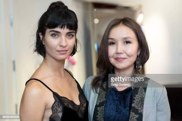 Actress Tuba Buyukustun and AWFF Cofounder and Managing Director Asel Sherniyazova attend a reception as Angelina Jolie Accepts the Rising Star Award...