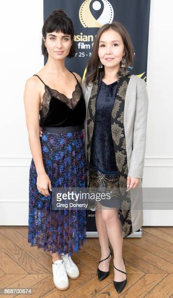Actress Tuba Buyukustun and AWFF Cofounder and Managing Director Asel Sherniyazova attend a reception as Angelina Jolie Accepts the Rising Star Award...