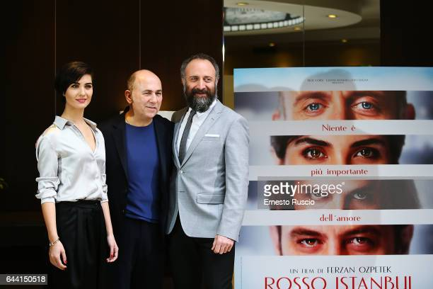Actress Tuba Buyukustun director Ferzan Ozpetek and actor Halit Ergenc attend a photocall for 'Rosso Istanbul' on February 23 2017 in Rome Italy