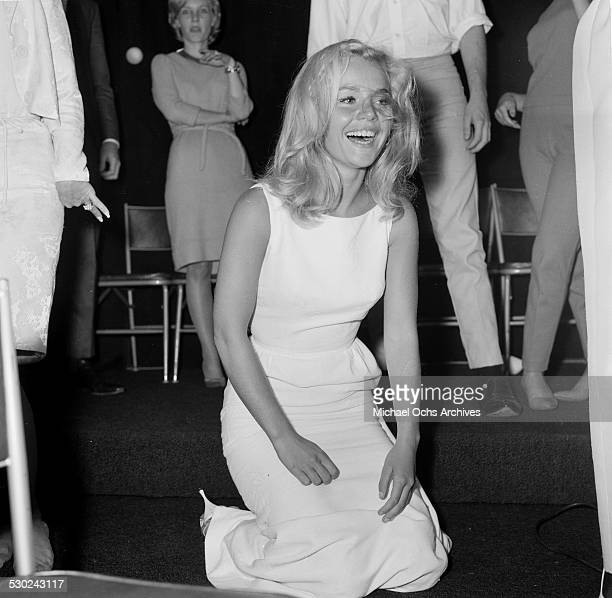 Actress Tuesday Weld slips dancing as she attends an event in Los AngelesCA