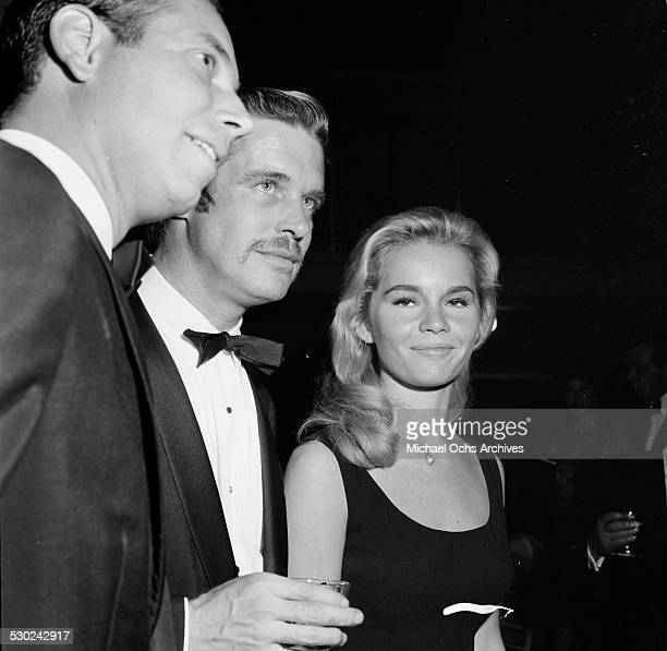 Actress Tuesday Weld with actor George Peppard attend an event in Los AngelesCA