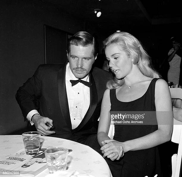 Actress Tuesday Weld with actor George Peppard attend an event in Los Angeles,CA.