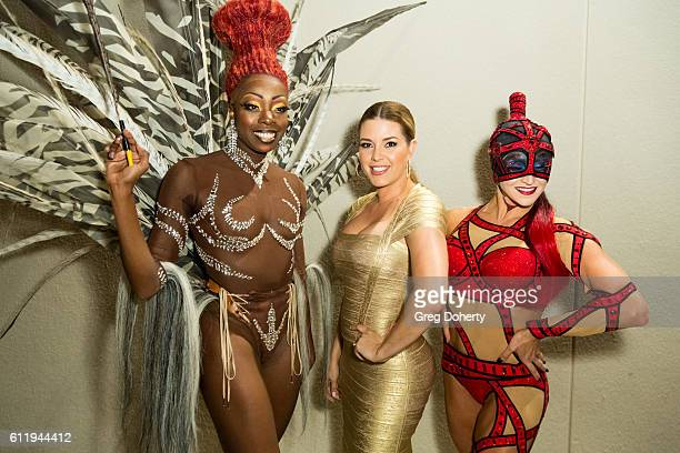 Actress TV host Singer Beauty Queen and former Miss Universe Alicia Machado poses for pictures with performers from Cirque Du Soleil at the...