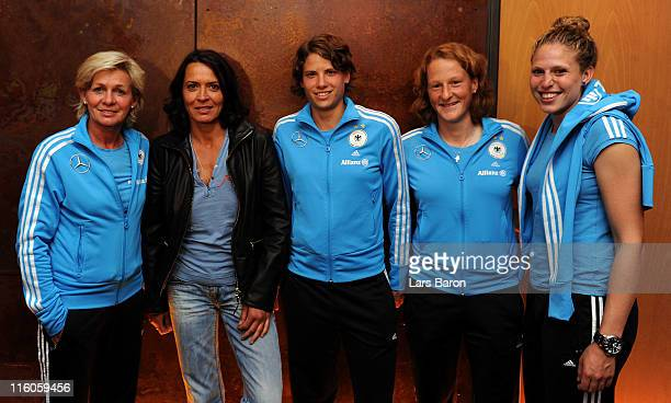 Actress Ulrike Folkerts is seen with head coach Silvia Neid and Annike Krahn Melanie Behringer and Kim Kulig during the German Women National Team...