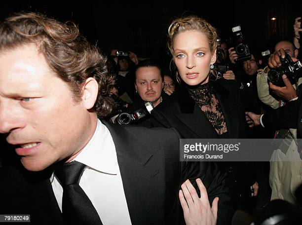 Actress Uma Thurman and Financier Arpad Busson leave the Valentino fashion show as part of Paris Fashion Week SpringSummer 2008 on January 23 2008 in...