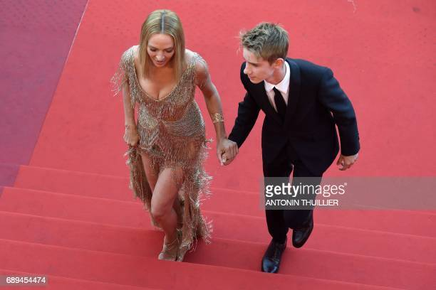 US actress Uma Thurman and her son Levon Roan ThurmanHawke arrive on May 28 2017 for the closing ceremony of the 70th edition of the Cannes Film...