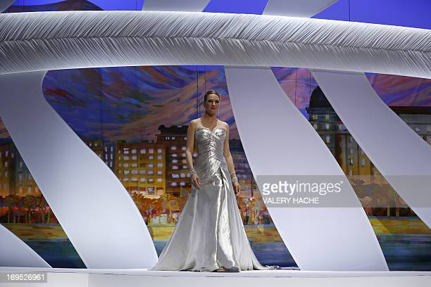 US actress Uma Thurman arrives on stage on May 26 2013 to announce the Palme d'Or award during the closing ceremony of the 66th Cannes film festival...