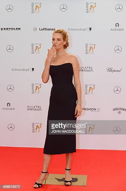 US actress Uma Thurman blows a kiss as she arrives for the Bambi awards on November 13 2014 in Berlin The Bambis are the main German media awards AFP...