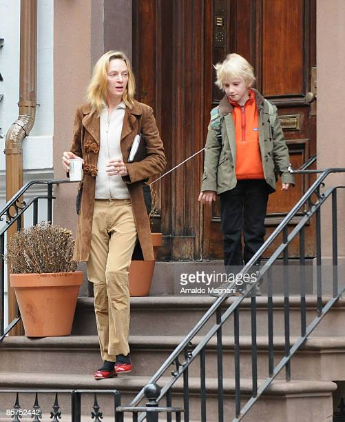 Actress Uma Thurman gets her earphones tangled with her son Levon Hawke as they leave their house April 1 2009 in New York City