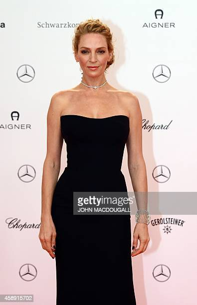 US actress Uma Thurman poses as she arrives for the Bambi awards on November 13 2014 in Berlin The Bambis are the main German media awards AFP PHOTO...
