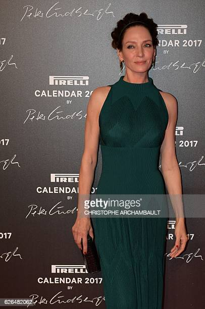 US actress Uma Thurman poses during a photocall ahead of a gala dinner held for the international launch of the 2017 Pirelli calendar at the Cite du...