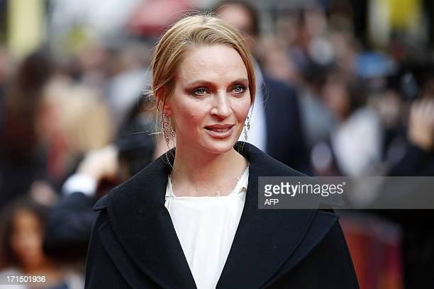 US actress Uma Thurman poses for photographers while arriving for the Premiere of West End musical Charlie and the Chocolate Factory at the Theatre...