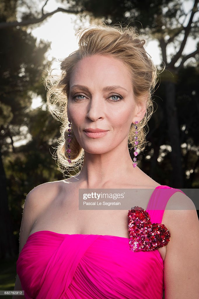 Actress Uma Thurman poses for photographs at the amfAR's 23rd Cinema Against AIDS Gala at Hotel du Cap-Eden-Roc on May 19, 2016 in Cap d'Antibes, France.