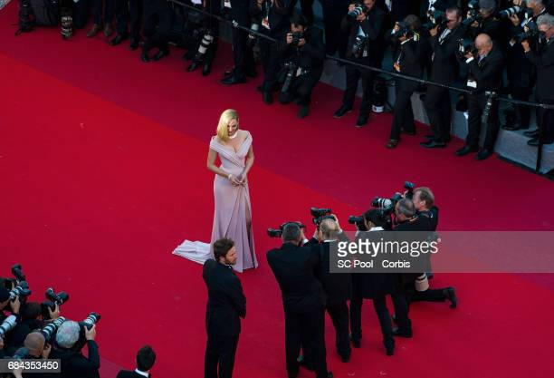 Actress Uma Thurman poses for the photographers before the 'Ismael's Ghosts ' screening and Opening Gala during the 70th annual Cannes Film Festival...