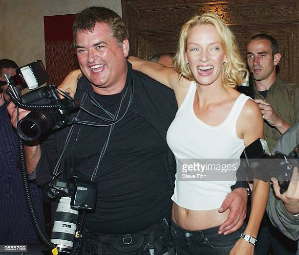 """Actress Uma Thurman poses with photographer Dave Hogan at a photocall to promote """"Kill Bill: Volume 1"""" at the Dorchester Hotel on Park Lane on..."""