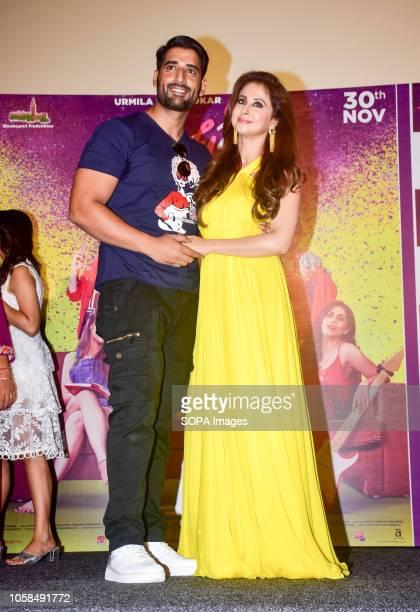 Actress Urmila Matondkar with her husband Mohsin Akhtar seen posing at the trailer launch of marathi film 'Madhuri' at Cinepolis Andheri in Mumbai