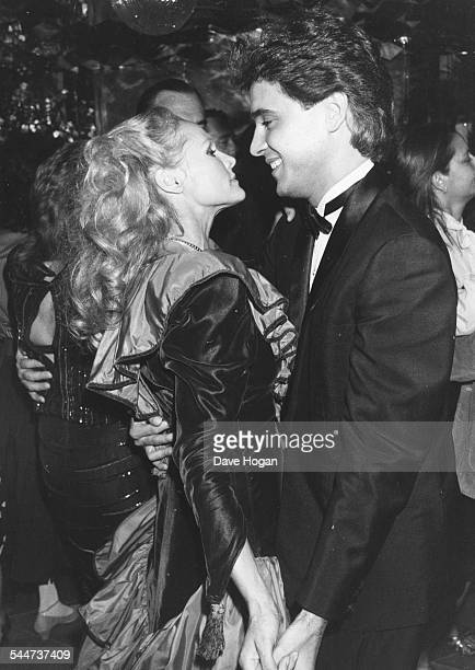 Actress Ursula Andress dancing with her date magazine editor Homero Machry at a party held for musician Julio Iglesias Paris September 30th 1983