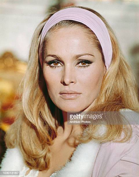 Actress Ursula Andress wearing a hairband with her hair falling over her shoulders circa 1965