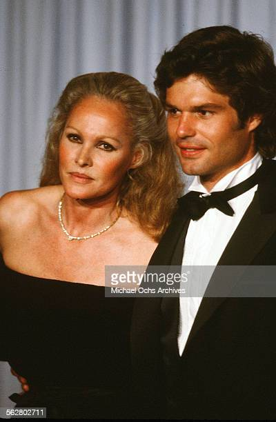 Actress Ursula Andress with actor Harry Hamlin pose backstage during the 54th Academy Awards at Dorothy Chandler Pavilion in Los AngelesCalifornia
