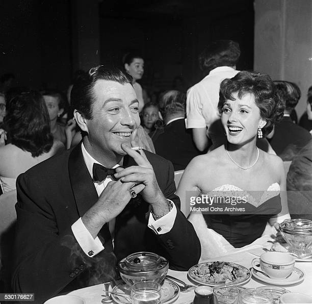 Actress Ursula Thiess attends the Golden Globe Awards with her husband Robert Taylor in Los AngelesCA