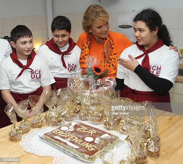 Actress Uschi Glas chats with schoolchildren in the new breakfast room at the HermannBoddinGrundschule elementary school on December 6 2010 in Berlin...