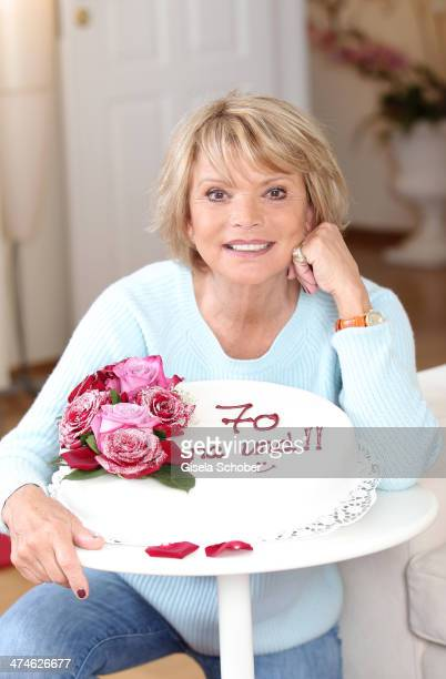 Actress Uschi Glas poses with a birthday cake prior to her 70th birthday on February 24 2014 in Munich Germany The actress turns 70 on March 2nd
