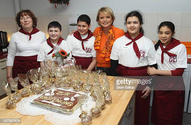 Actress Uschi Glas poses with children in the new breakfast room at the HermannBoddinGrundschule elementary school on December 6 2010 in Berlin...