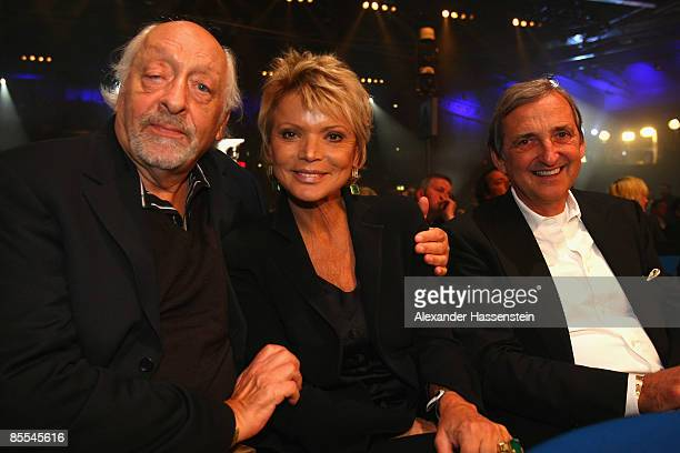 Actress Uschi Glas poses with Entertainer Karl Dall and Dieter Hermann prior to the WBC World Championship Heavyweight fight at the...