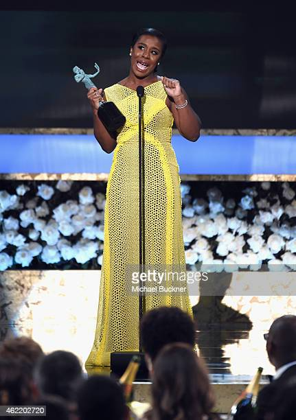 Actress Uzo Aduba accepts an award onstage during TNT's 21st Annual Screen Actors Guild Awards at The Shrine Auditorium on January 25, 2015 in Los...