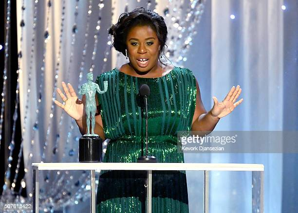 Actress Uzo Aduba accepts Outstanding Performance by a Female Actor in a Comedy Series for 'Orange Is the New Black' during the 22nd Annual Screen...