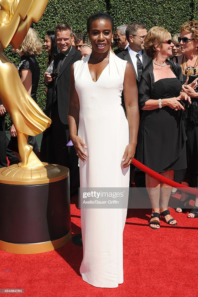 Actress Uzo Aduba arrives at the 2014 Creative Arts Emmy Awards at Nokia Theatre L.A. Live on August 16, 2014 in Los Angeles, California.