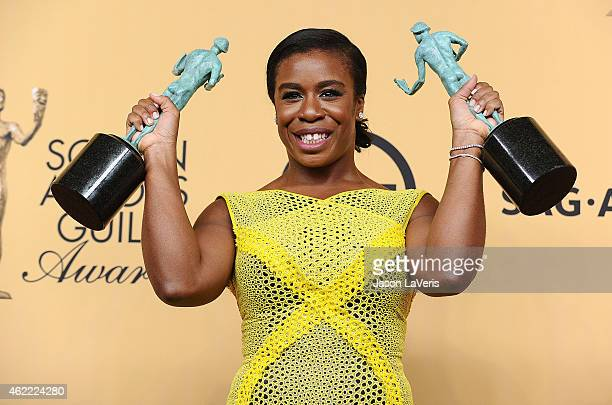 Actress Uzo Aduba poses in the press room at the 21st annual Screen Actors Guild Awards at The Shrine Auditorium on January 25, 2015 in Los Angeles,...