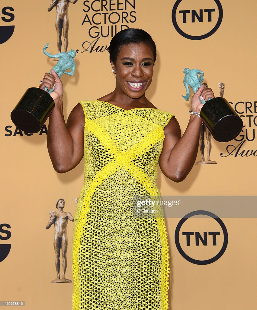 Actress Uzo Aduba poses in the press room at the 21st annual Screen Actors Guild Awards at The Shrine Auditorium on January 25, 2015 in Los Angeles, California.