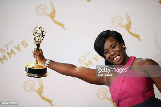 Actress Uzo Aduba winner of the award for Outstanding Supporting Actress in a Drama Series for 'Orange Is the New Black' poses in the press room at...