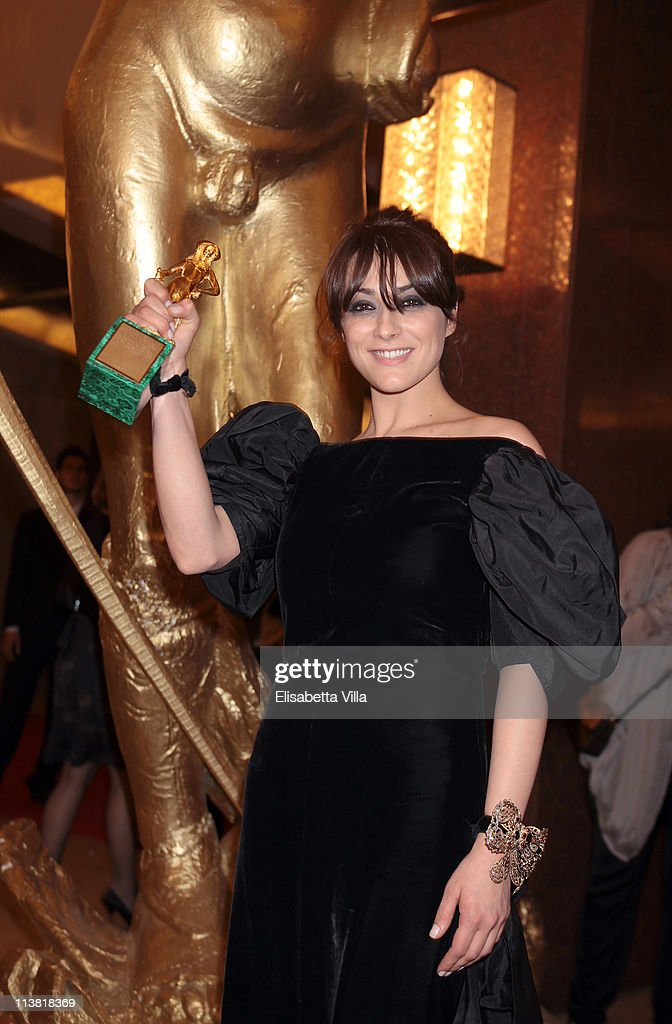 Actress Valentina Lodovini shows her award for the Best Supporting Actress at the end of 2011 Premi David di Donatello Italian Academy Awards at Auditorium della Conciliazione on May 6, 2011 in Rome, Italy.