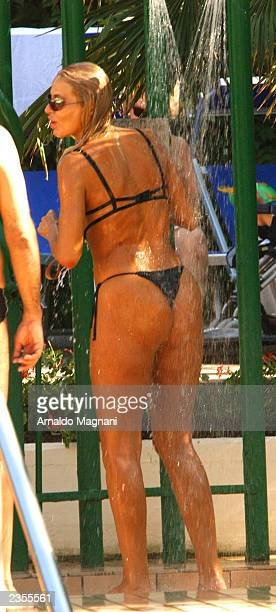 Actress Valeria Marini emerges from a swimming pool at the Mare Pineta Hotel on July 20 2003 in Milano Marittima Italy
