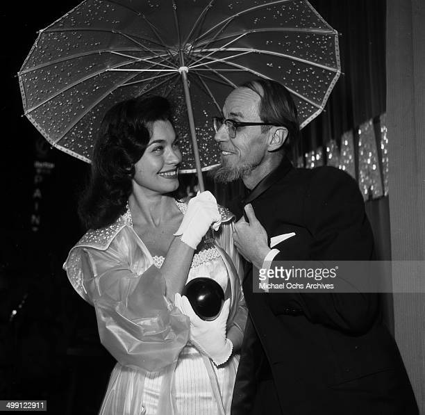 Actress Valerie Allen attends a premiere of The Rainmaker with photographer Earl Leaf in Los Angeles California