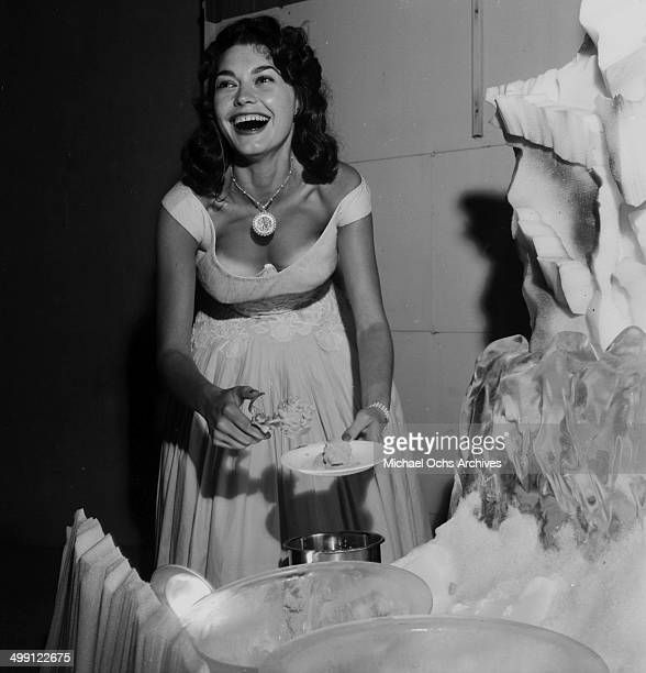 Actress Valerie Allen serves ice cream during a party in Los Angeles California