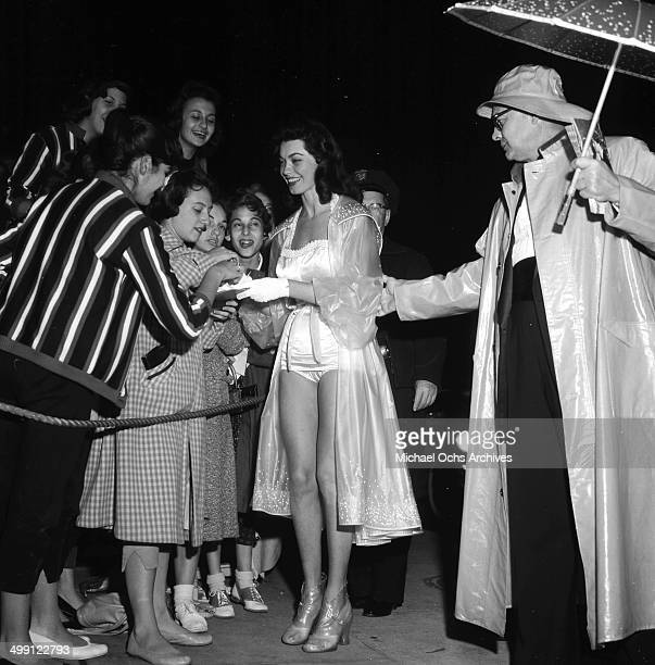 Actress Valerie Allen signs autographs at a premiere of The Rainmaker in Los Angeles California