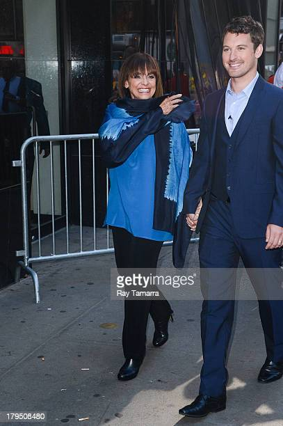 Actress Valerie Harper and dancer Tristan MacManus leave the Good Morning America taping at the ABC Times Square Studios on September 4 2013 in New...