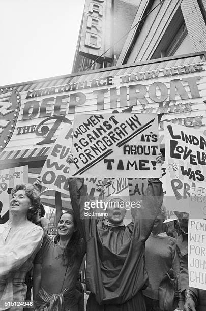 Actress Valerie Harper holds up sign reading Women Against Pornography in front of a movie theater showing the 1972 pornographic film Deep Throat in...