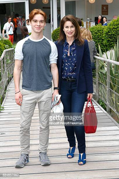 Actress Valerie Kaprisky and her Nephew attend Day Seven of the 2016 French Tennis Open at Roland Garros on May 28 2016 in Paris France