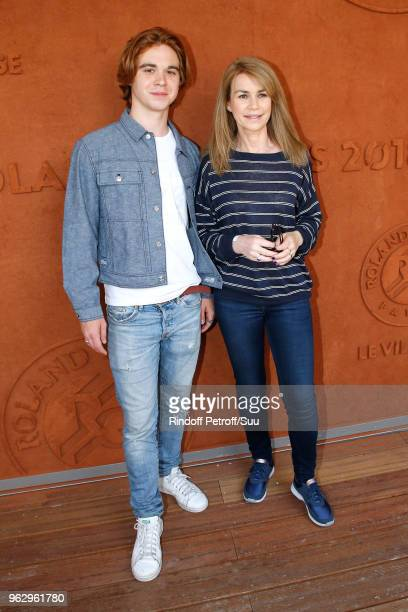 Actress Valerie Kaprisky and her son Lucas Stephnik attend the 2018 French Open Day One at Roland Garros on May 27 2018 in Paris France