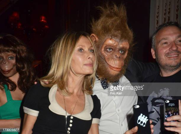 Actress Valerie Steffen and a member of the 'Monkey Crashers' attend 'Apero Chic' Party At Hotel Pershing Hall on July 11 2013 in Paris France