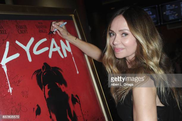 "Actress Vanessa Angel signs the poster at the Premiere Of Parade Deck's ""Lycan"" held at Laemmle's Ahrya Fine Arts Theatre on August 15 2017 in..."